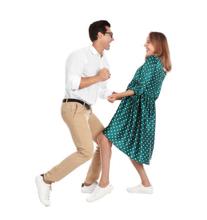 Beautiful young couple dancing on white background Stock Photo