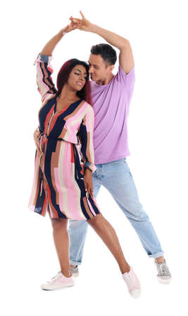 Beautiful lovely couple dancing on white background
