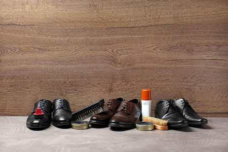 Footwear and shoe shine kit on grey surface, space for text