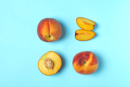Sweet juicy peaches on light blue background, flat lay Фото со стока
