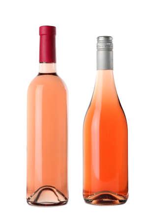 Bottles of delicious rose wine on white background. Mockup for design