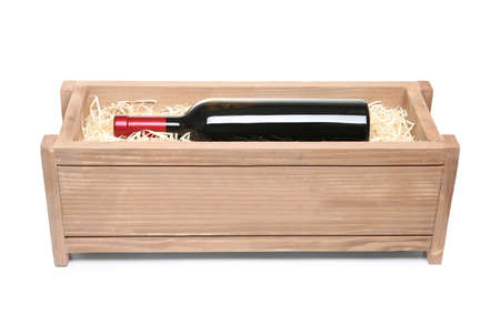 Open wooden crate with bottle of wine isolated on white