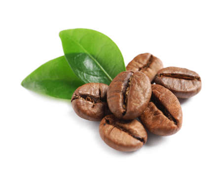 Roasted coffee beans and fresh green leaves on white background 스톡 콘텐츠