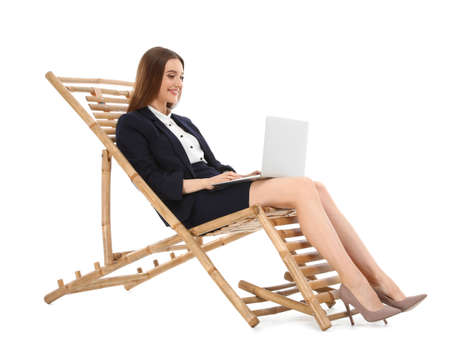 Young businesswoman with laptop on sun lounger against white background. Beach accessory