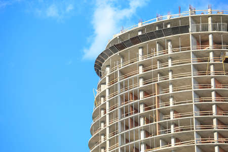 Unfinished building against blue sky, space for text. Construction safety rules