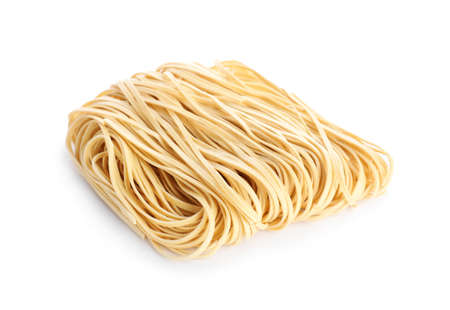 Block of raw egg noodles isolated on white Zdjęcie Seryjne