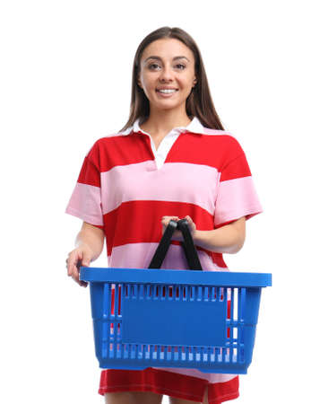 Young woman with empty shopping basket isolated on white Banco de Imagens