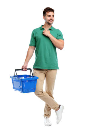 Young man with empty shopping basket isolated on white Banco de Imagens