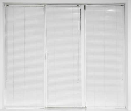 Window with closed modern horizontal blinds indoors
