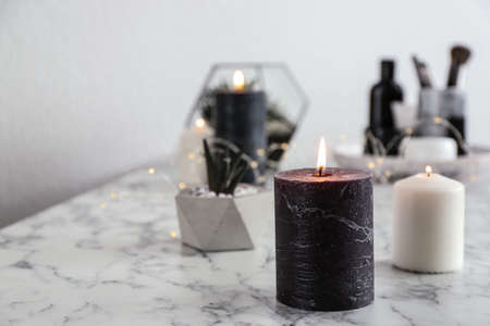 Burning candles on marble table, space for text 版權商用圖片