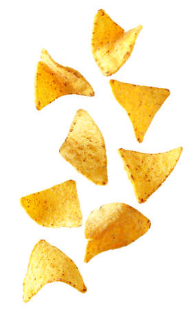 Flying delicious Mexican nachos chips on white background Stock Photo