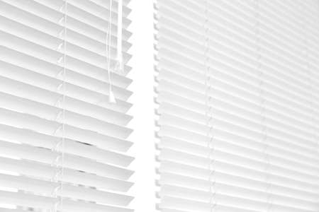 Window with modern horizontal blinds indoors. Space for text