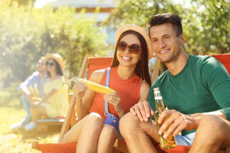 Happy friends having picnic in park on sunny day Stock Photo
