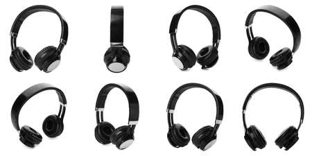 Set of modern black headphones on white background