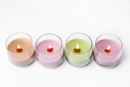 Color wax candles in glass holders isolated on white Reklamní fotografie