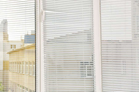 Window with open modern horizontal blinds indoors