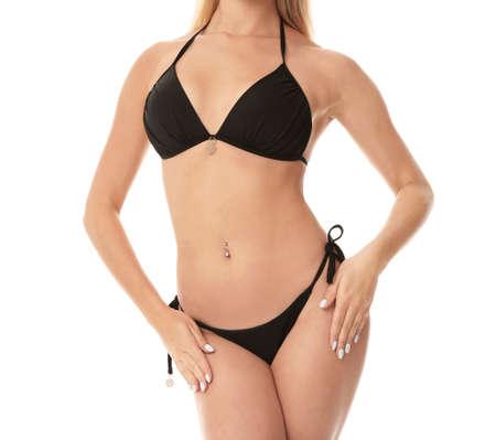 Young woman wearing stylish bikini on white background Фото со стока