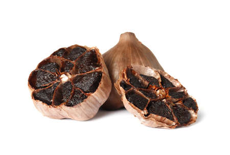Aged black garlic on white background. Asian cuisine