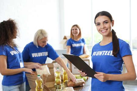 Portrait of happy female volunteer in uniform indoors
