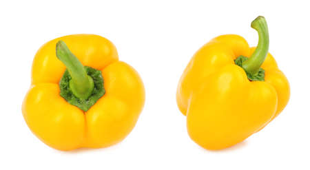 Ripe yellow bell peppers on white background