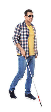 Blind man with long cane on white background