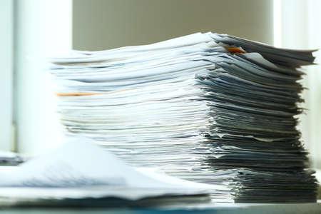 Stacks of documents on desk in office Archivio Fotografico