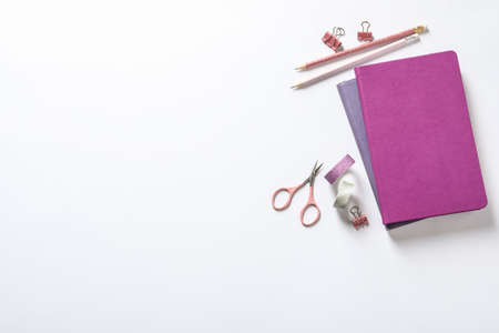 Composition with scissors and stationery on white background, top view