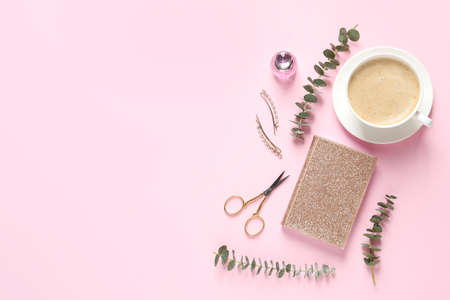 Flat lay composition with scissors, coffee and notebook on pink background. Space for text Stock Photo