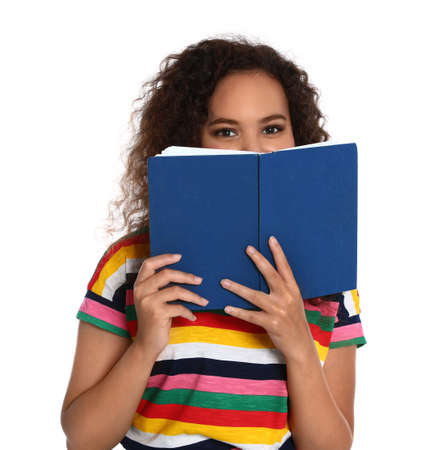 Beautiful African-American woman with book on white background. Reading time