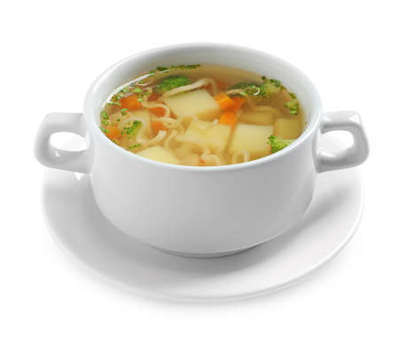 Dish of fresh homemade vegetable soup on white background