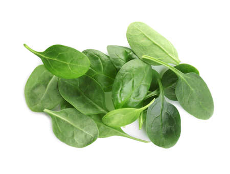 Pile of fresh green healthy baby spinach leaves on white background, top view