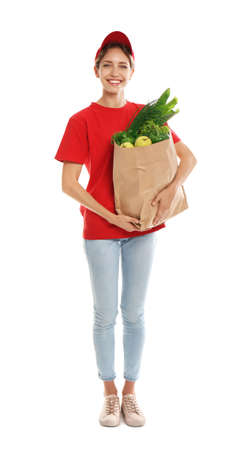 Delivery woman with bag of fresh vegetables on white background Zdjęcie Seryjne