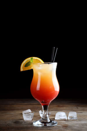Just made appetizing cocktail Sex on the Beach, black background