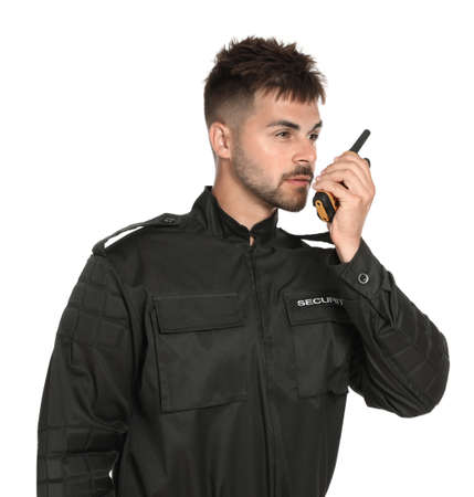 Male security guard in uniform using portable radio transmitter on white background