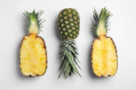 Tasty ripe pineapples on white background, top view Stockfoto