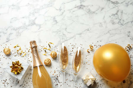 Flat lay composition with bottle of champagne for celebration on white marble background. Space for text Standard-Bild