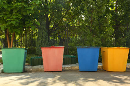 Recycling bins for different types of garbage outdoors Stock Photo