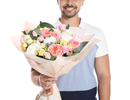 Young man with beautiful flower bouquet on white background, closeup view