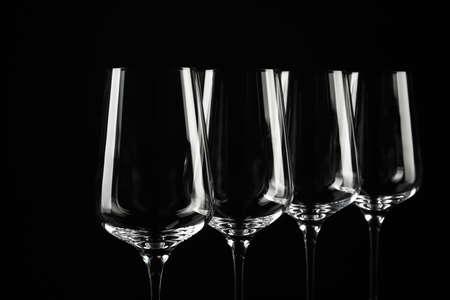 Set of empty wine glasses on black background
