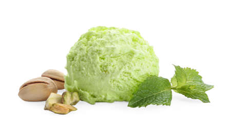 Scoop of delicious pistachio ice cream with mint and nuts on white background Imagens