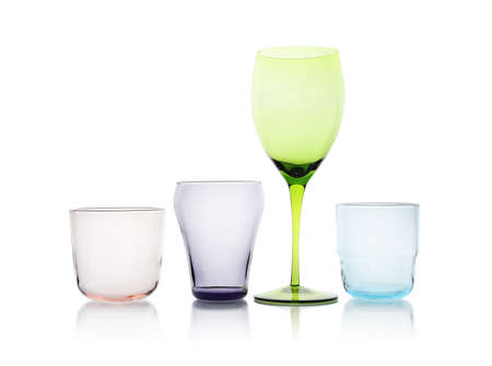 Set of colorful empty glasses on white background