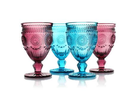 Empty elegant colorful glasses on white background