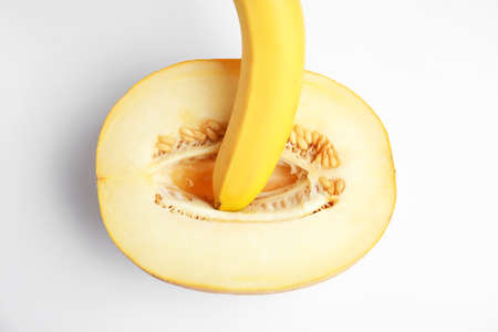Fresh melon and banana on white background, top view. Sex concept