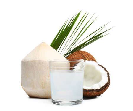 Glass of coconut milk and nuts on white background Imagens