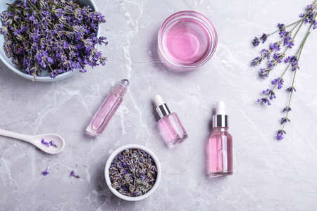 Flat lay composition with lavender essential oil on marble background 写真素材