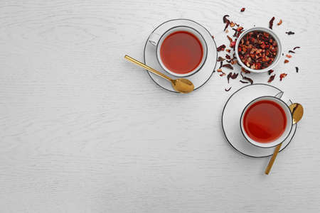 Composition with hibiscus tea on white wooden background, flat lay. Space for text Stock Photo