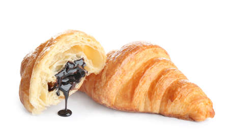 Tasty croissants with chocolate on white background. French pastry Banco de Imagens