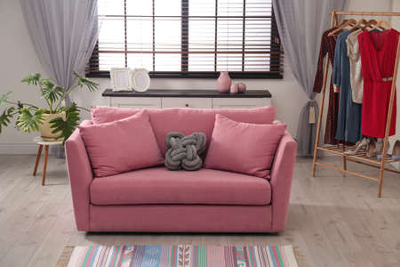Comfortable sofa near window in stylish living room interior 写真素材