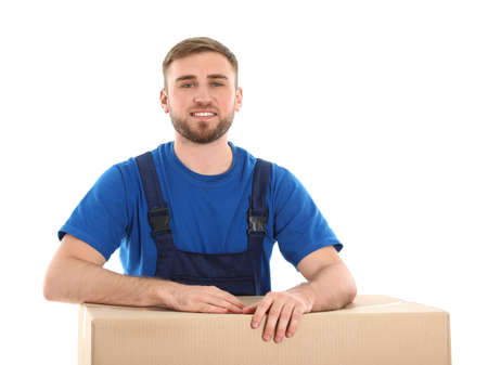 Young worker with box isolated on white. Moving service