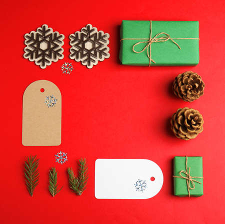 Frame made with Christmas decor on red background, flat lay. Space for text